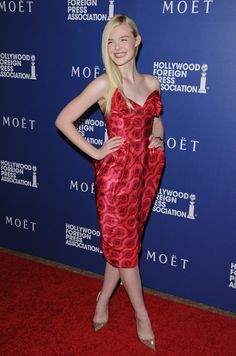Stunning in red at an event in Beverly Hills.    - ELLE.com