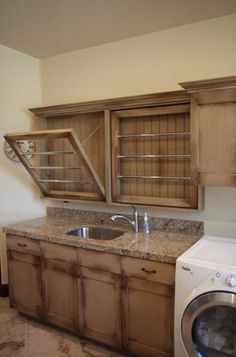 drying racks and built in sink and storage in the laundry room