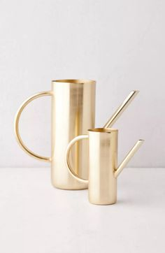 Gleaming metal watering can featuring a slim cylindrical basin topped with a narrow spout and arching handle. Exclusive to Urban Outfitters. Make Money Online, How To Make Money, Metal Watering Can, Aesthetic Bedroom, Pattern Mixing, Roxy, Basin, Planting Flowers, Cleaning Wipes