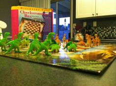 Check out our find from Bookmans: Checkersaurus Rex! It's checkers with  tiny dinosaurs as the pawns and tiny T-Rex's as the kings!   http://boardgamegeek.com/boardgame/22214/checkersaurus-rex