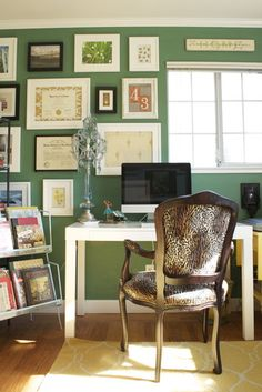 really like the gallery wall- a nice mix of art prints and degrees/diplomas etc., perfect to display all the professional degrees  licenses without the room feeling stuffy or pretentious Emerald Office - eclectic - home office