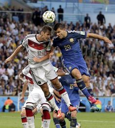 FIFA World Cup 2014 - Alemania 1 Argentina 0 (7.13.2014) Argentina's Sergio Aguero heads the ball against Germany's Miroslav Klose during the World Cup final soccer match between Germany and Argentina at the Maracana Stadium in Rio de Janeiro, Brazil, Sunday, July 13, 2014. Felipe Dana / AP