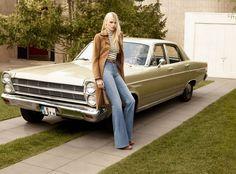 1970's high-waist flared denim, short tucked in shirt, long jacket.