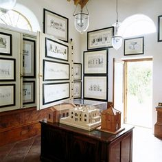 If it's a case of too many pictures, not enough wall, take a leaf from the book of architect Craig Hamilton, who has transformed his garage in to space in which to display his architectural drawings and models. The framed pictures are hung on Soane-style space-saving double panels.  Taken from the May 2011 issue of House & Garden