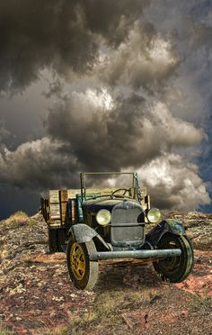 Just Plain COUNTRY CHARM... Love this picture of the old truck and ominous clouds.