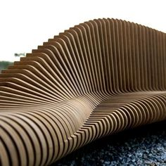 Called Urban Adapter, the project features a computer model that uses data about the intended site to generate the form of a bench, which is then constructed from wooden profiles.