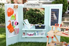 DIY Folding make believe station. Can be used as a grocery, hardware store, puppet theater. Lemonade stand, anything you can think of!
