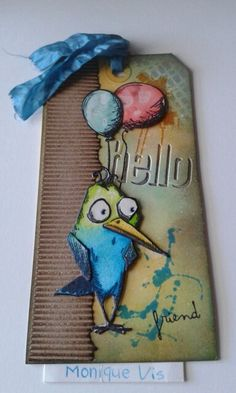 Tag met distressink en bird grazy stamps van Tim Holtz... Monique
