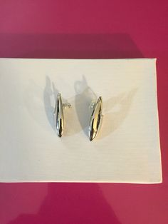 Silver Tone Flame Earrings by Monet