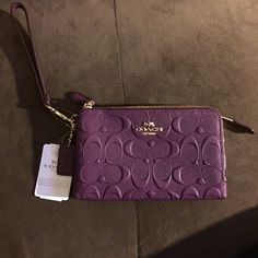 Coach Dbl Zip Wristlet Brand new w/tags. 100% authentic. 2 fabric credit card slots inside, 2 zipper compartments. Color is Plum.☺️ if coach gift box needed please let me know  Coach Bags Clutches & Wristlets