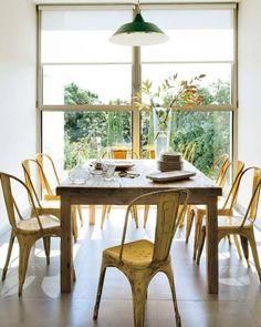 love the big window and yellow chairs