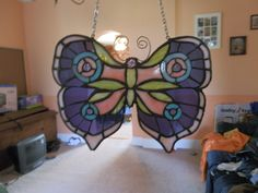 Custom stained glass done in Huntington Indiana. Childs butterfly