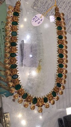 Gorgeous gold long haaram with Ram parivar kasu and emeralds. Long haaram with Ram parivar kasu hangings. Ruby Necklace Designs, Jewelry Design Earrings, Gold Jewellery Design, Gold Jewelry, Gold Necklace, India Jewelry, Short Necklace, Gold Bangles, Pearl Jewelry