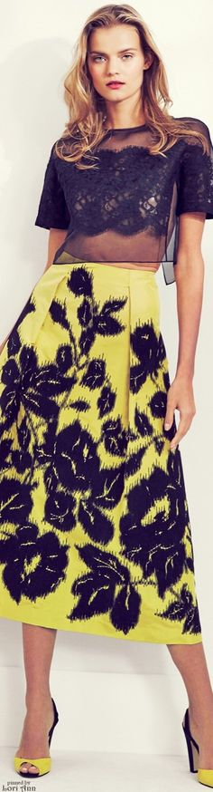 Carolina Herrera Resort 16: black cropped lace top, floral print canary yellow maxi skirt.