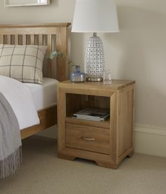 The Bevel Natural Solid Oak Bedside Table is a versatile unit which is designed to provide extra storage space beside the bed or even in the living room to hold a lamp. Oak Furniture Land, Living Room Furniture, Living Room Decor, Table Lamps For Bedroom, Bedside Table Lamps, Nightstand, Side Table With Storage, Classic Living Room, Front Rooms