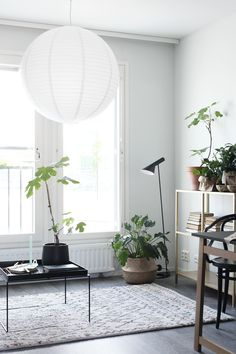 Susanna Vento for YIT Smartti // styling with green plants. Living room ready for Spring