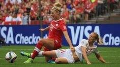 Lara Dickenmann of Switzerland tackles Lauren Sesselmann