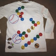 Back of 100th day of school shirt using 100 sports balls
