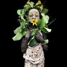flower mouth...Photographs of the Ethiopian Surma Tribe by Mario Gerth