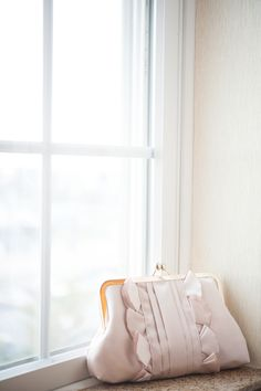 Blush pink bridal clutch Photography by