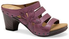 Introducing the Dansko Spring/Summer 2013 shoes! Dansko's new Nigella sandal is a must-have! It has a classic slip-on design, flower accent, and brass stud accents. You can see the other colors available on our website!