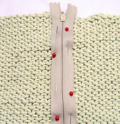 Step-by-step tutorial on how to sew in a Zipper in your crochet or knit item, by Crochet Today
