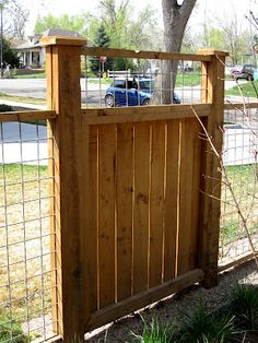 back fence inspiration. I don't like the gate but i like the fence to keep bruce in and not destroy the view!