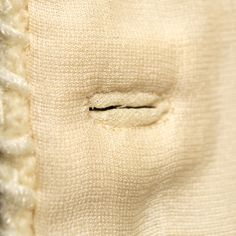 1960's Chanel jacket. Lining of buttonhole, KSUM 1986.46.2a