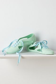 Made to wear in the rain. Perfect for summer in the tropics! Adorable ... and wonderful Caribbean blue color.  They also come in a conch coral color. Love these!