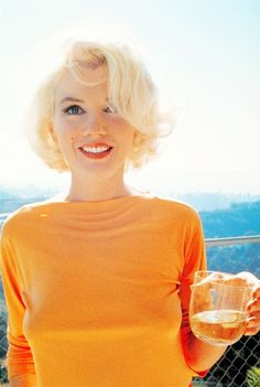 Marilyn Monroe is bright orange top