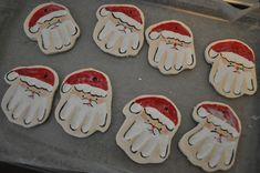 making hand print santa ornaments