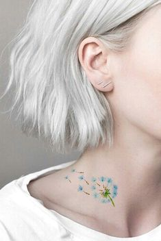 Small Watercolor Blowing Dandelion Neck Tattoo - Delicate Feminine Colorful Flower Tat - Pequeño tatuaje de cuello de diente de león que sopla de acuarela - www.MyBodiArt.com