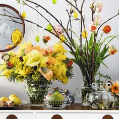 Decorate for Easter with colorful glass eggs and vases with yellow flowers.