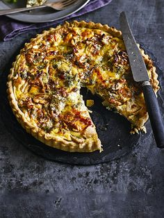 Pear and blue cheese tart with walnut pastry - A lovely vegetarian main for your Christmas dinner or a dish to add another element to a Boxing Day buffet. Shop-bought shortcrust pastry makes life easy and is given a clever twist with added walnuts. You can use up any leftover blue cheese for the wintery pear and blue cheese filling