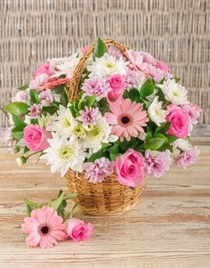 Buy or Send a mix of pink flowers arranged in a woven basket. This classic gift idea is ideal for an anniversary, a get well soon or a loved ones brithday or newly mother in South Africa.