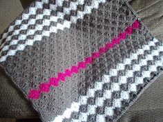 Baby M Blanket---I like the gray and white color scheme with the simple pop of fuchsia.