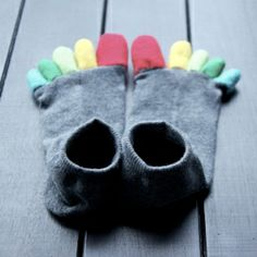 Learn how to make your own colorful toe socks from a pair of old socks and fabric scraps with this tutorial