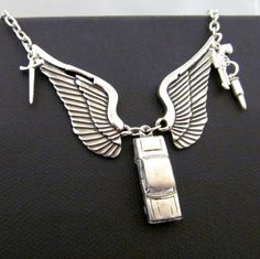 Destiel:  A Dean Winchester / Castiel, Supernatural inspired charm necklace.  $25.00 by Mazikeen Studios on Etsy.