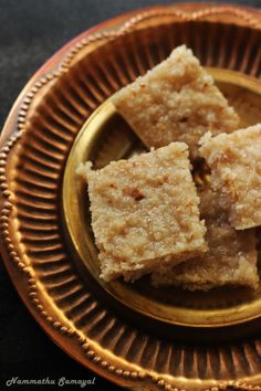 This is coconut burfi with a twist. We had so much leftover candied cashews from mundiri paruppu thenga koodu. So made use of ...
