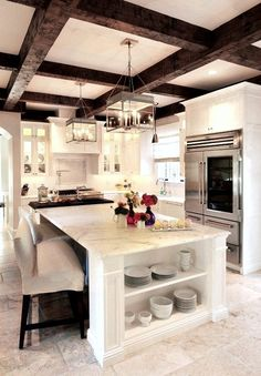 White Kitchen with Exposed Wood Beams