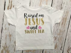 A personal favorite from my Etsy shop https://www.etsy.com/listing/467473677/raised-on-jesus-and-sweet-tea-toddler