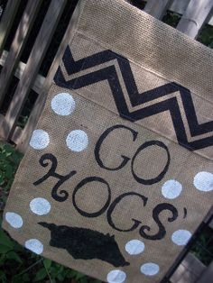 elouiseboutique.com $20 + $3 shipping Hog Fan Garden Flag, Handpainted Burlap with a black Chevron topper! Adorable Cottage Chic! Excited about this season ?!? Let's go Hogs! Show your Arkansas pride with a custom designed garden Flag! (Flag pole not included) 17in. x 12.5in. Designed, sewn, & painted in Arkansas with pride, by a Native Arkansan! Now taking Holiday orders & Custom orders welcome!