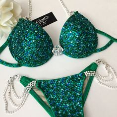 """Are you looking for a crystal bikini in a push up bra style? This is the """"Abbie"""" suit available in any color variation your little heart desires! to customize this look contact info@mayracollection.com #green #glamfit #glam #fitness #fitspo #fitspiration #fitnessmodel #bikinipro #fitnessmotivation #fitfam #bestoftheday #fitnessgirl #bikinidivision #bikinifitness #bikinimodel #bikinicompetitor #wbffpro #wbffdiva #wbffbikini #custombikini #compsuit #compbikini #giftideas #ifbbpro"""