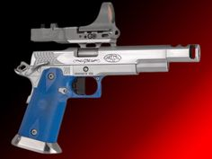 The STI Grandmaster with C-More Red Dot Scope--perhaps the coolest pistol evermade.