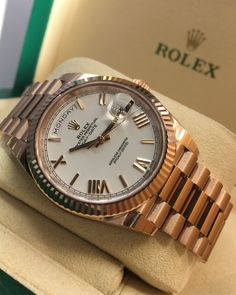Rolex Day-Date 40 Rose Gold White Roman Dial 228235