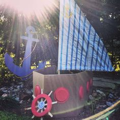 Cute Cardboard sailboat for a photo op, and I love the huge Anchor in the background! -Sailor/nautical Birthday Party Ideas | Photo 47 of 53 | Catch My Party