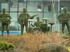 Life-sided topiary figures of the Beatles adorn the traffic island at Liverpool's South Parkway rail station