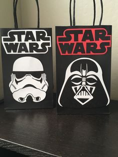 Star Wars Party Bags (please look at all pictures before ordering) Each set comes with 10 bags. 5 Stormtroopers and 5 Darth Vader. All the characters are hand cut, layered, and hand drawn. Heavy glitter card stock used on both characters. * wont always look identical* Stormtrooper measures approximately Height 5 inches Width 4 inches Darth Vader measures approximately Height 5 inches Width 5 inches Star Wars letters Height 2.25 inches Width 5 inches All on black, kraft paper bags with bl...