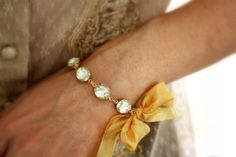 Sweet ribbon-tie bracelet.  Rhinestones are vintage.