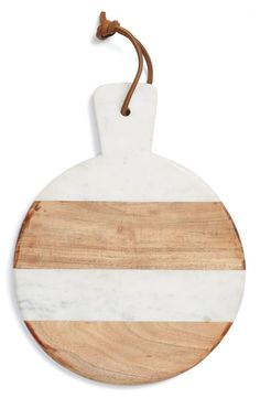 Marble and wood compose this smooth, elegantly shaped serving board ideal for showcasing appetizers or desserts when entertaining guests. This Nordstrom Anniversary Sale find will definitely be a great addition to the home.